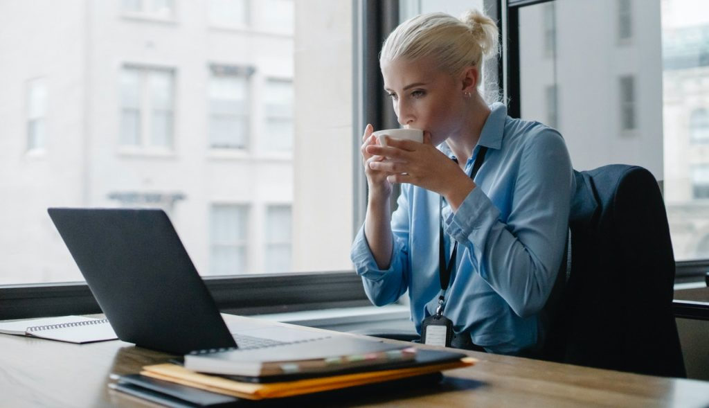 office worker drinking coffee in healthy office