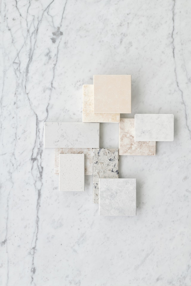 different types of marble tiles stacked on top of one large marble tile that makes up the background